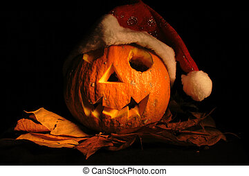 halloween pumpkin with santa cap in the dark night