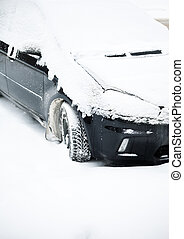 car with snow cover - winter urban concept (natural...