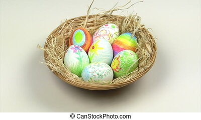 Easter eggs in a basket rotating