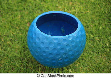 golf ball blue grass green