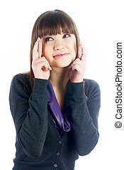Girl with crossed fingers - Young woman showing crossing...