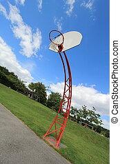 Basketball hoop - Red basket ball hoop on an out door court...