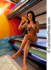 Girl in solarium - Beautiful young woman tanning in solarium