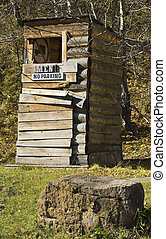 Out House - Old rustic outhouse with humorous signs
