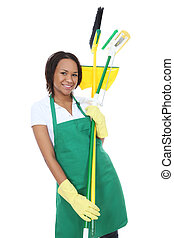 African Woman Maid - A pretty woman maid cleaner holding...