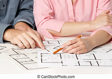 Family house planning - Young couple planning living...