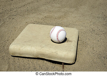 Baseball on base - Sport backgroun: new white baseball with...