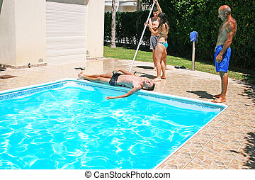 People at swimming pool - Woman throwing her friend to...