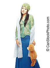 Play with toy - Young lady in the stylish clothes holding...