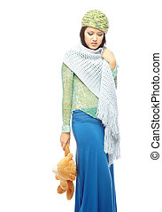 Fashion with toy - Young lady in the stylish clothes holding...