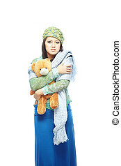 Sad lady with toy - Sad young lady holding the toy on a...