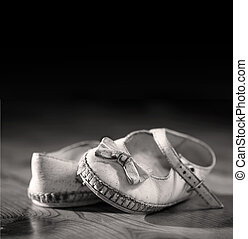 Old shoes - A pair of worn out baby shoes. Nostalgic image...