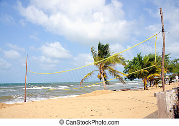 Beach recreation - Volleyball net set up on a beach in the...
