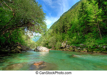 Clear Alpine river Soca in Slovenian Alps