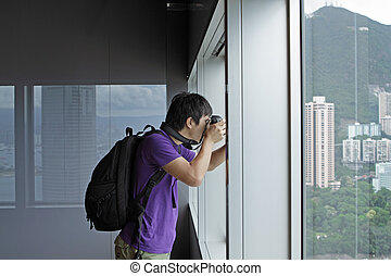 photographer takes a photo of the landscape indoor