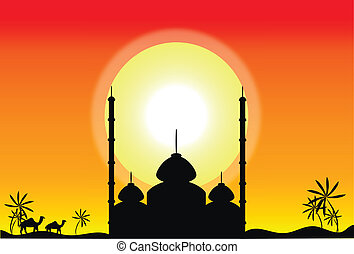 Silhouette of mosque at sunset