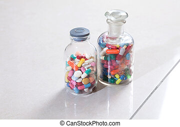 Bottle of medicine - Two bottles with tablets and capsules