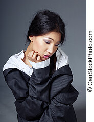 Lady with pimples - Sad Asian lady in the studio with...