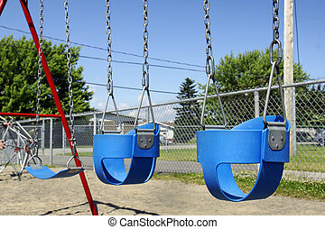 Empty baby swings - Empty blue plastic swings for baby or...