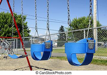 Empty baby swings - Empty blue plastic swings for baby or...