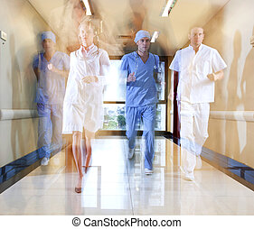 Team of doctor and nurse running in hallway of hospital