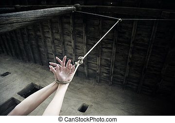 Punishment - Woman hands hanged on the rope in ancient...