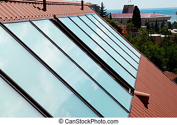 Solar panels (geliosystem) on the house roof.