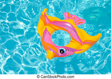 Swimming pool float - A safety float drifts in a swimming...