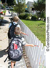 Kids walking home from school - Two young boys walk home...