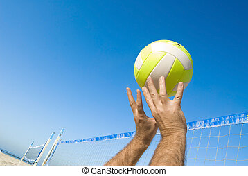 Volleyball player - A volleyball player lobs a ball during a...