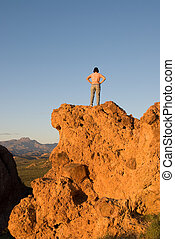 Mountain top and woman - A woman makes it to the top of a...