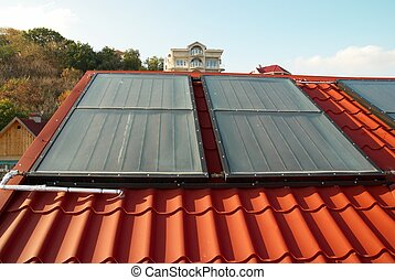 Alternative energy- solar system on the house roof.
