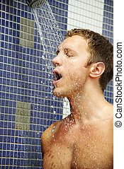 Man under the shower - Portrait of handsome blond man under...