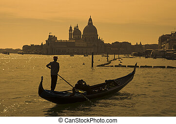 Gondolier in Venice, Italy - Gondolier at the dusk in...