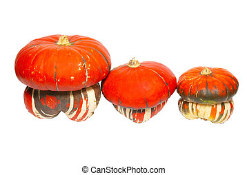 Three red pumpkins isolated on white.