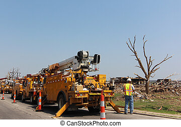 EF5 Tornado Damage Repair Underway - Utility workers are...