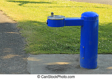 Thirst Quencher - Cool blue drinking water fountain outdoors...