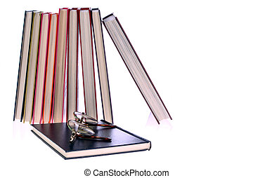 hardcover books and glasses on White Background