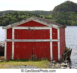 old wooden fishing shack taken from the side of the road -...