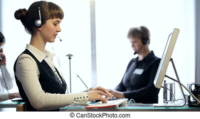HD: call centre at work - HD: three people working at a call...