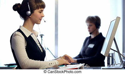 HD: women working at a call centre - HD: two women working...