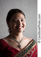 Beautiful Indian happy woman in red - Smiling Indian happy...
