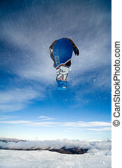 Snowboarder jumping through