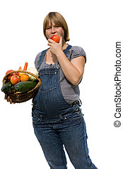 Young pregnant woman with a fruit basket for healty...
