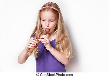 Little gril with recorder - Little girl in purple dress...