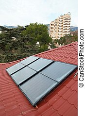 Solar panel (geliosystem) on the red roof.