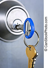 Keys in lock - Keys inserted in door lock close up