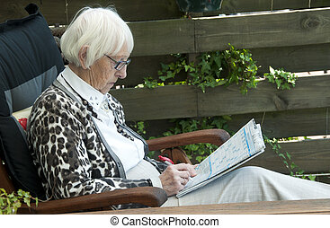 grandm solving puzzle - grandma solving a puzzle in the news...