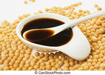 Soy sauce and soybean on white background,not isolated