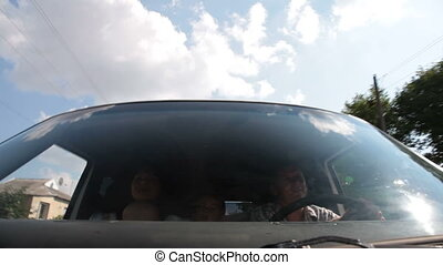 traveling by car - young family with two children traveling...